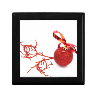Red christmas ball with twig on white background gift box