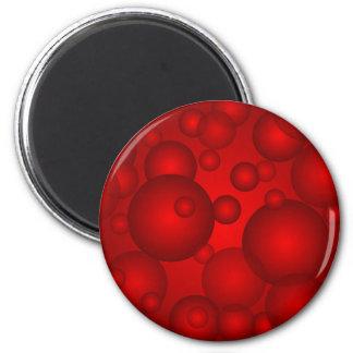 Red circler on a red backgroiund magnet
