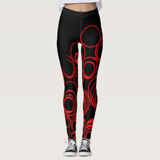 Red circles scrolls ovals on black canvas pattern leggings