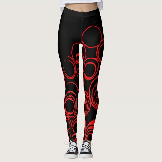 Red circles scrolls ovals on black canvas pattern leggings