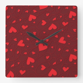 Red curly hearts wallclock