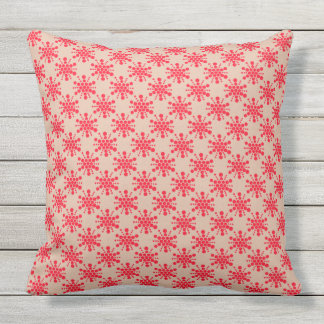 Red dotted star on taupe outdoor pillow