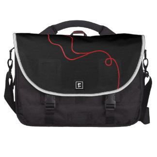 Red earphones laptop bag