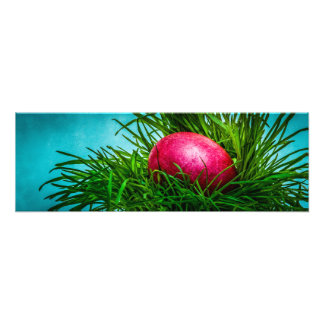 Red Easter egg in the grass Photo