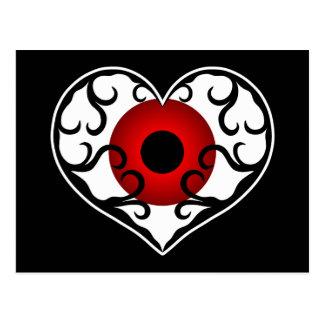Red eyeball in heart postcard