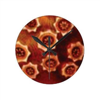 red flower cluster round clock