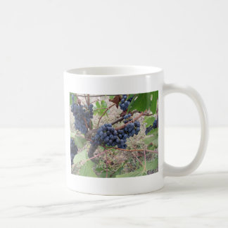 Red grapes on the vine with green leaves coffee mug
