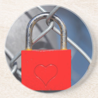 Red heart lock on fence drink coaster