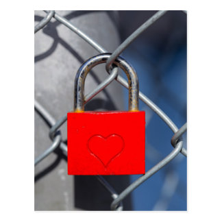 Red heart lock on fence postcard