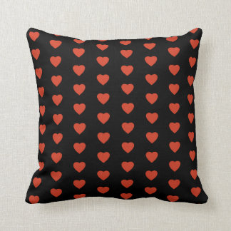 Red hearts on black background throw pillow