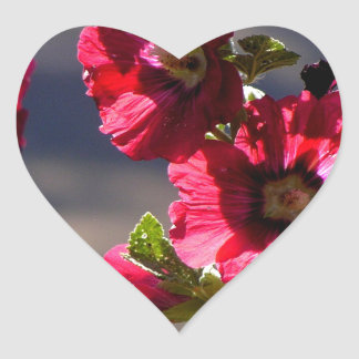 Red Hollyhocks in a summer garden Heart Sticker