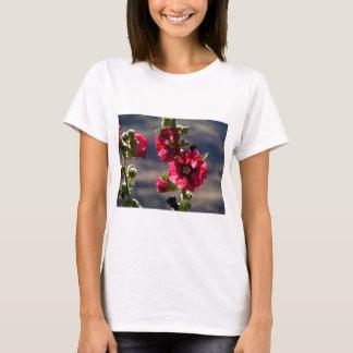 Red Hollyhocks in a summer garden T-Shirt