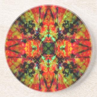 Red kaleidoscope star pattern coaster
