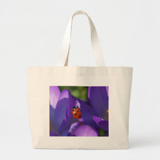Red ladybird on crocus large tote bag
