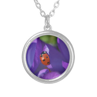 Red ladybird on crocus silver plated necklace