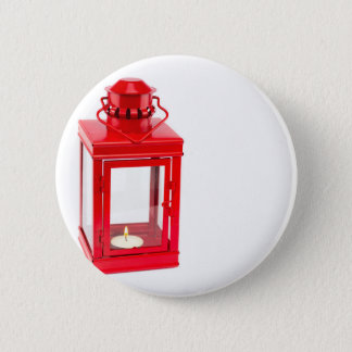 Red lantern with burning tealight on white 2 inch round button