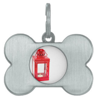 Red lantern with burning tealight on white pet ID tag