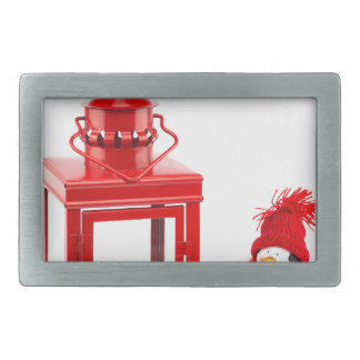 Red lantern with penguin figurine on white belt buckle