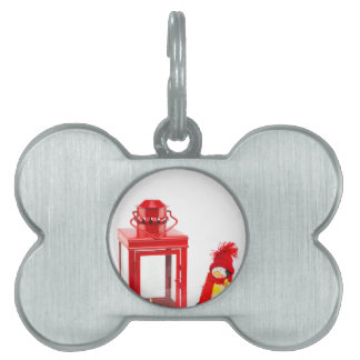 Red lantern with penguin figurine on white pet name tag