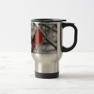 Red male cardinal in the winter travel mug