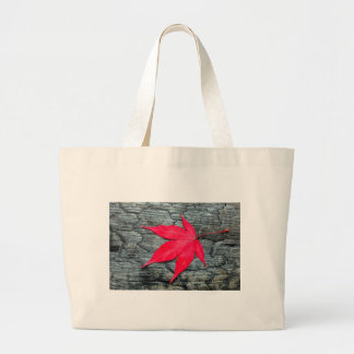 Red maple leave on black burnt wood large tote bag