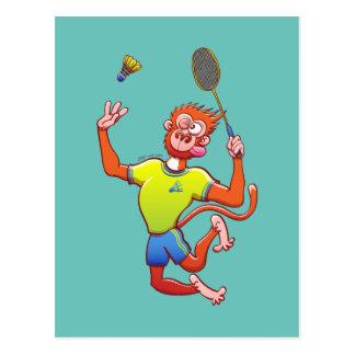 Red monkey playing badminton postcard