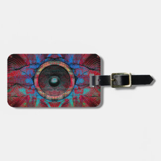 Red music speakers on a cracked wall luggage tag