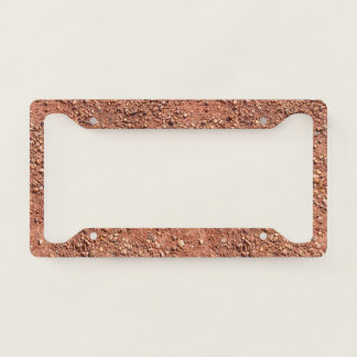 Red ochre sand and pebbles license plate frame