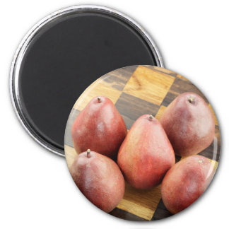 Red Pears on a Wooden Chess Board 2 Inch Round Magnet