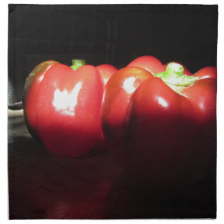 Red peppers illuminated by sunshine in the dark printed napkin