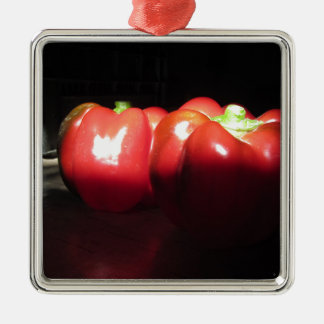 Red peppers illuminated by sunshine in the dark Silver-Colored square ornament