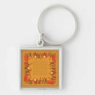 Red peppers on a light gold background keychain