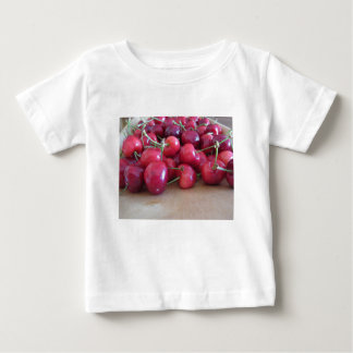 Red ripe cherries on wooden tray baby T-Shirt