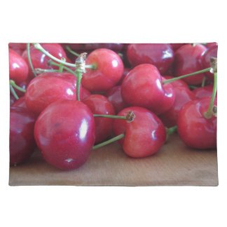 Red ripe cherries on wooden tray placemat