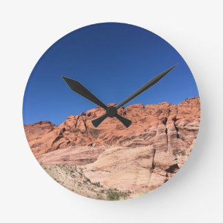 Red rocks and blue skies wall clock