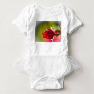 Red rose close up design baby bodysuit