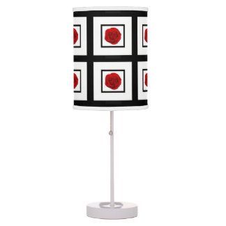 Red rose on black white (desk) table lamp