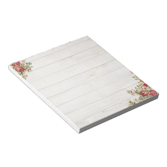 Red roses on wood notepad