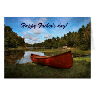 Red rustic canoe on the bank of the lake card