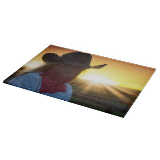 Red Scarves and Sunset Cowgirl Cutting Board