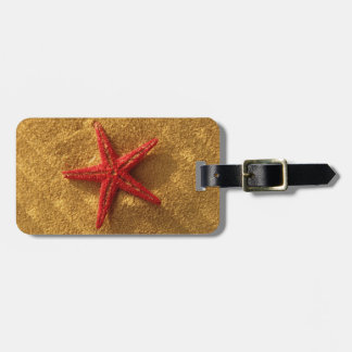 red starfish luggage tag