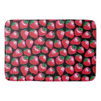 Red strawberry on  black background bath mat