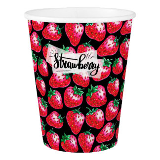 Red strawberry on  black background paper cup