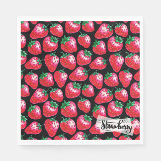 Red strawberry on  black background paper napkin