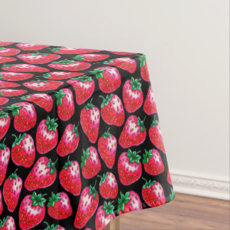 Red strawberry on  black background tablecloth