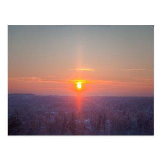 Red sundown on winter day postcard