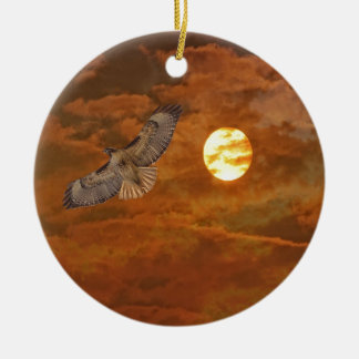 Red Tailed Hawk and Red Skies Round Ceramic Ornament
