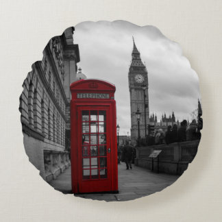 Red telephone box in London round pillow