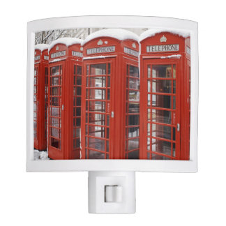 Red telephones near Big Ben Night Lights