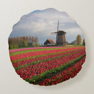 Red tulips and a windmill round pillow